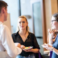 Female student networking with peers