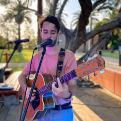 Musician playing in twilight at UQ Gatton campus