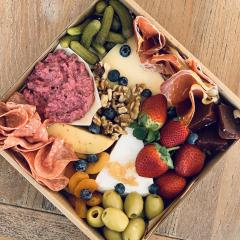 Picnic box including cheese, meats, olives and strawberries at the 2020 BLOOM Festival