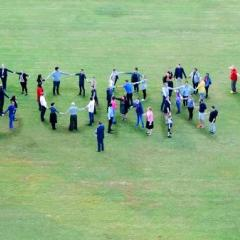 UQ community spelling out Sorry on Forgan Smith Lawns for National Sorry Day